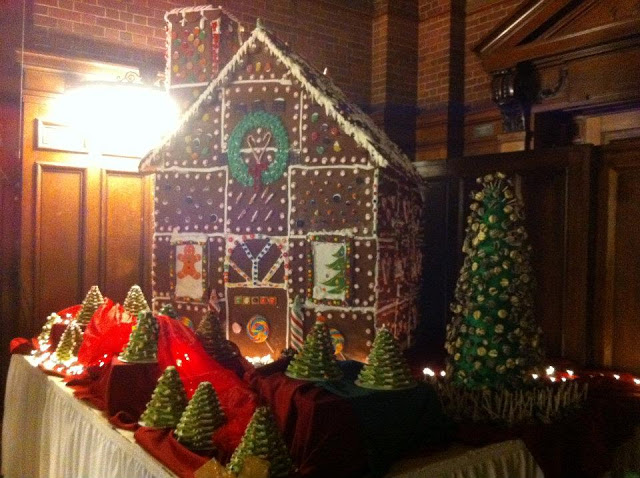An enormous gingerbread house on display at the Holiday Dinner.