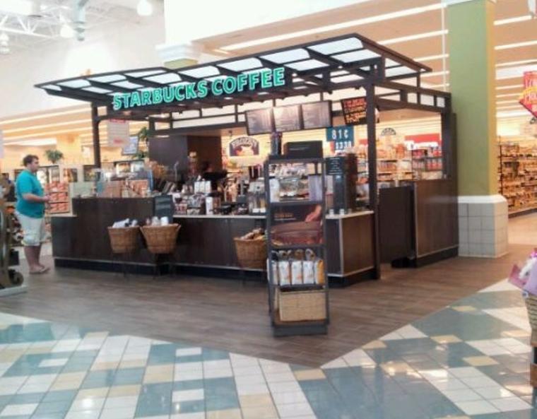 a Starbucks kiosk inside a grocery store