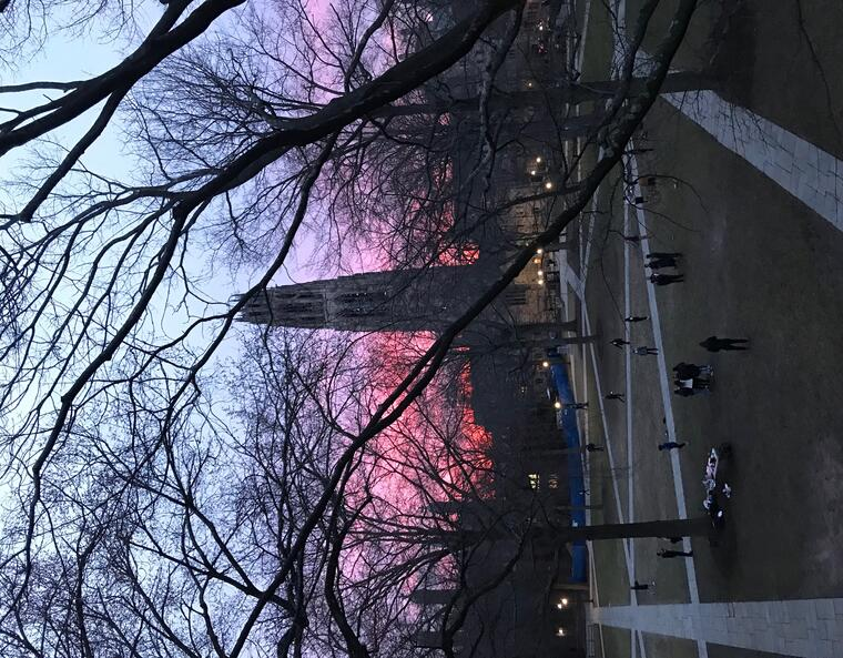 Harkness tower in front of a pink and purple sunset