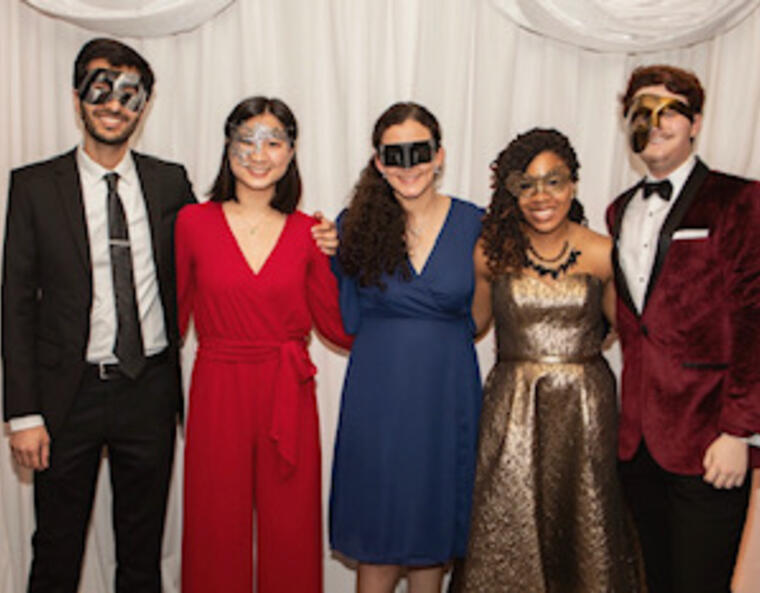 my friends and me in the photo booth at masquerade