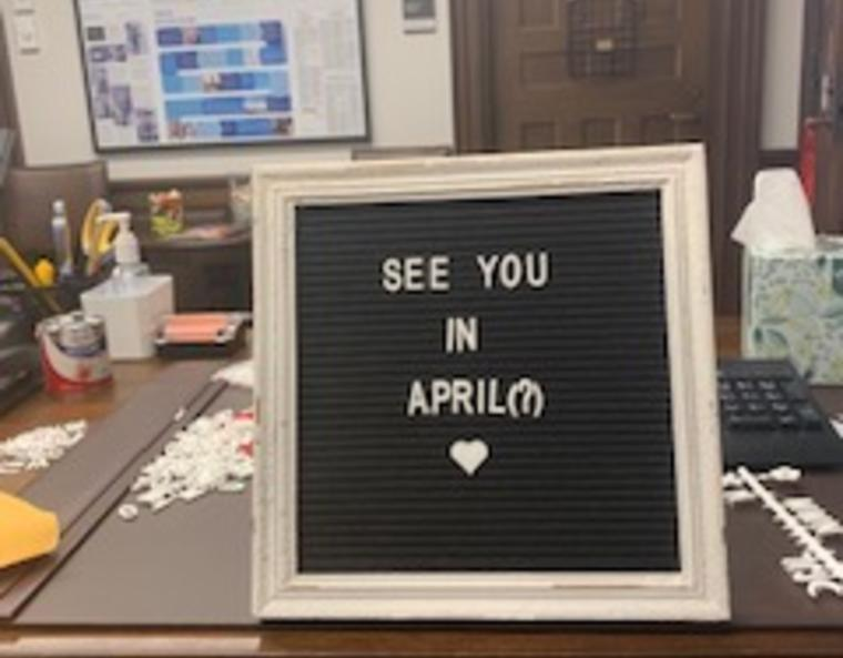 "a sign reading ""See You In April(?)"""