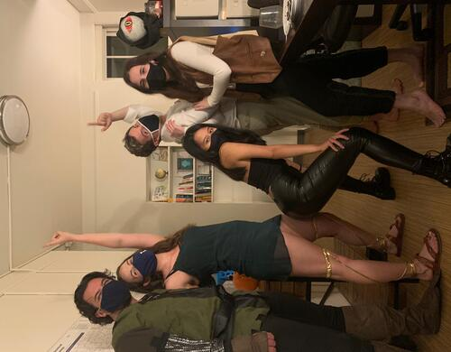 5 people pose in masks