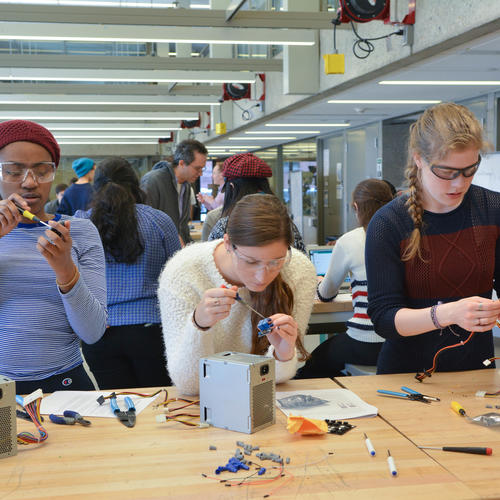 Three female engineers at work at the Center for Engineering Innovation and Design