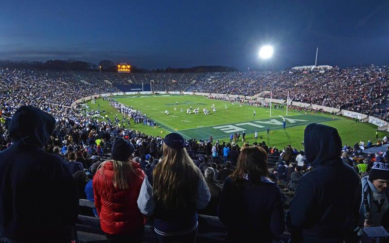 students cheer at the Yale Bowl