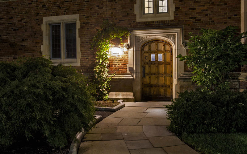 An entryway in Grace Hopper College illuminated at night