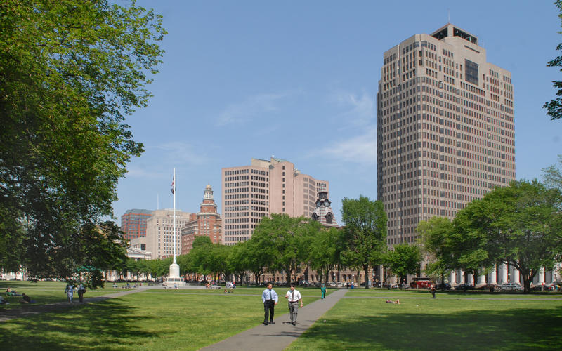 People walk through the New Haven Green