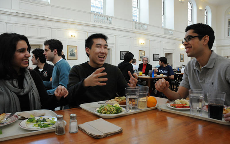 A group of students enjoying a meal in the Pierson College dining hall.
