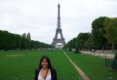 A Yale student, with the Eiffel Tower standing tall in the background.