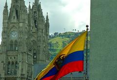 The flag of Ecuador flapping in the wind in front of the Basílica del Voto Nacional in Quito.