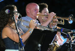 A group of jazz musicians mid-performance.