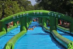 Children sliding down the world's longest inflatable water slide.