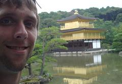 The author smiling with a Japanese pagoda in the background.