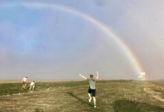 People chasing after a rainbow
