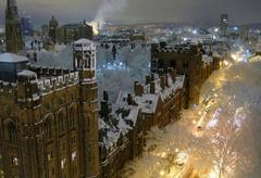 A nighttime aerial view of the Yale campus after a snowstorm.