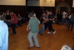 Students swing-dancing in pairs.